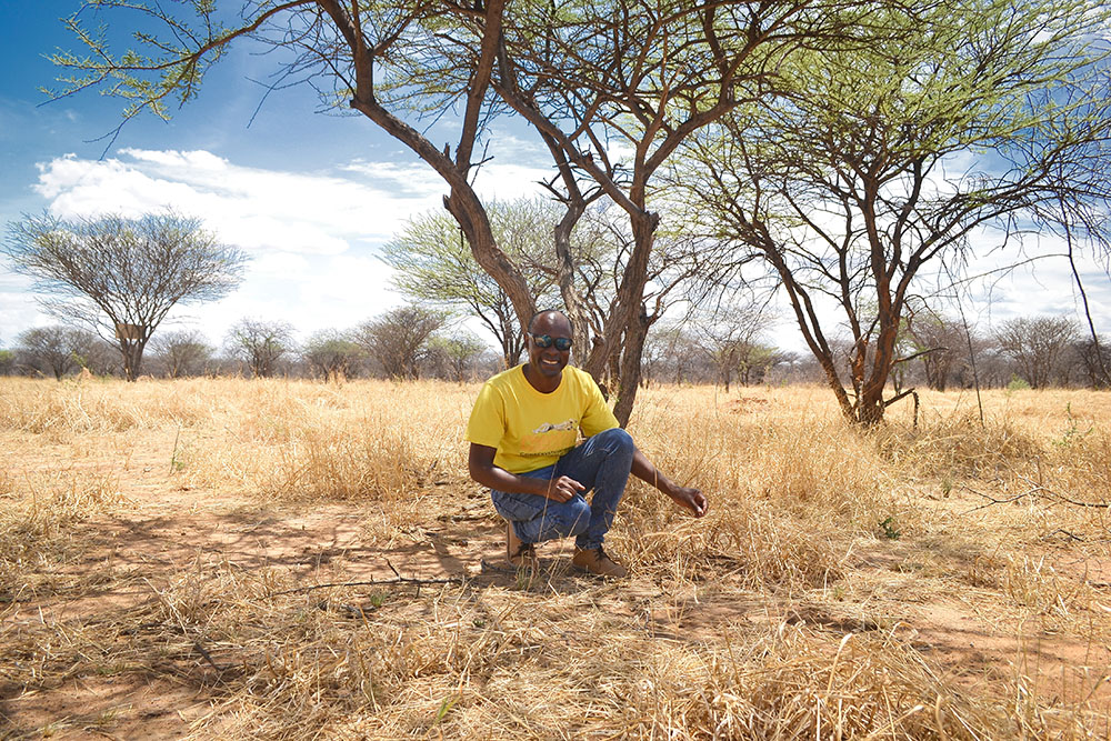 Matti T. Nghikembua shows variety of grass species in an area that has been bush-thinned on the CCF Nature Reserve